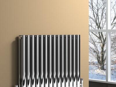 Nerox Double horizontal radiator polished on a cream wall