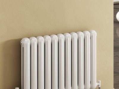 Reina Coneva horizontal radiator on a beige wall